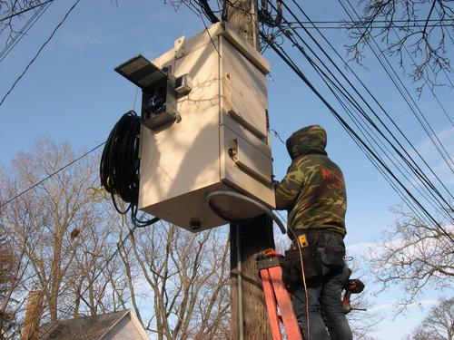 A LightSpeed technician installs a fiber distribution hub on a Lansing street. Each hub is capable of serving fiber to more than 400 homes.