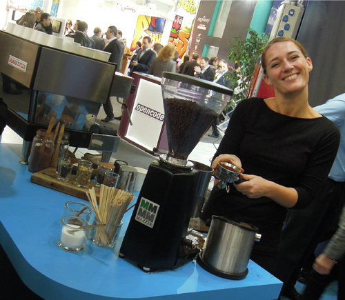 Top barista and all round fab person Daisy Rollo preps another cup of magic at the Spirent stand on the MWC show floor.