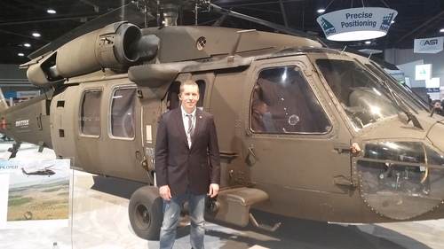 Light Reading CEO Stephen Saunders poses alongside a Sikorsky helicopter at the Unmanned Systems 2015 show in Atlanta, Ga.