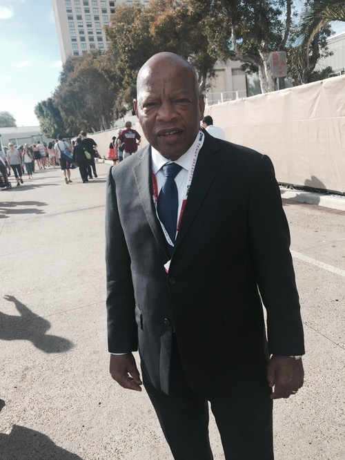 Congressman John Lewis didn't need a costume -- he really is a superhero. Lewis participated in the civil rights marches that desegregated the US South in the 1960s and was one of the original 13 Freedom Riders who risked police tear-gas and beatings with clubs. Lewis has written a series of graphic novels to teach about the experience to a new generation. He was there to promote it dressed as... himself, wearing a raincoat and knapsack, as he wore on the marches.