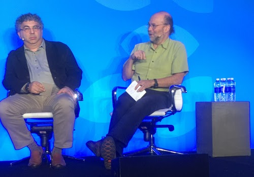 Jeff Mogul, Google's principal software engineer (right), discusses building reliable services from unreliable parts, while Hal Stern, executive director of applied technology for Merck, listens.