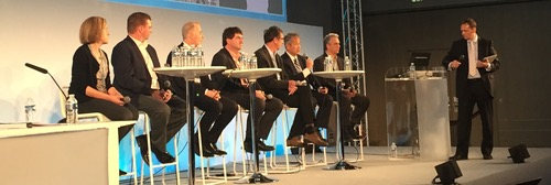Executives from the first of two service-provider debates at MPLS/SDN/NFV World Congress, including (from left to right) AT&T's Maria Napierala, Verizon's Chris Emmons, Colt's Mirko Voltolini, Deutsche Telekom's Axel Clauberg, Orange's Francois Bertret, NTT's Kohei Shiomoto and Telecom Italia's Paolo Fasano.