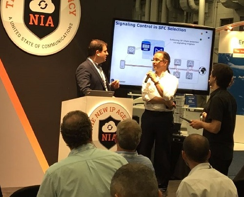 EANTC Managing Director Carsten Rossenhovel (center with microphone) discusses NFV interoperability during the live test demo at the Big Communications Event (BCE) 2016.