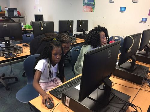 Girls at Charleston's Sanders-Clyde Elementary-Middle School learn to code in the YWCA's after-school program. (Source: The Post and Courier)