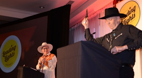 The 'fun' part of the Leading Lights awards dinner often has a local flavor... Light Reading's CEO and founder Steve Saunders whips out his pistol at the 2016 awards ceremony in Austin, Texas.