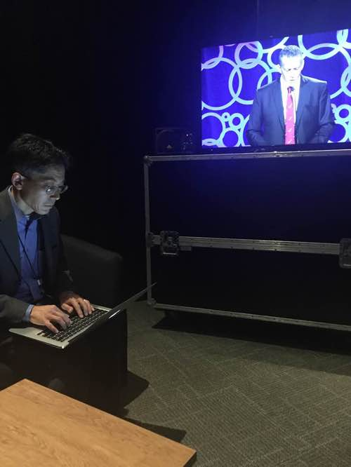 Craig Matsumoto, Light Reading editor in chief, works backstage while Steve delivers the opening keynote. (Wilson.)