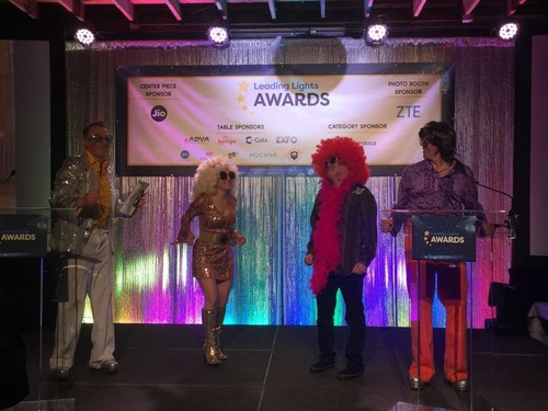 The conference kicked off with the annual Leading Lights awards, honoring the best accomplishments and most distinguished leaders of the industry. This year's awards ceremony had a 70s theme. Here in their disco finest are Ray Le Maistre, Light Reading international group editor; Julie Muroff, our senior vice president of operations; Mobile Editor Dan Jones, and CEO and Founder Steve Saunders. (Photo by Carol Wilson.)