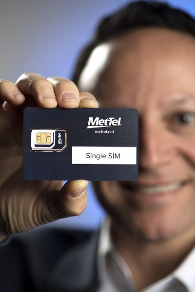 MetTel VP for Mobility and IoT Max Silber displays the IoT Single SIM which self-reports real-time on-session activity, providing a current view of product/component status and location. (Photo source: Jon Simon/Feature Photo Service for MetTel)