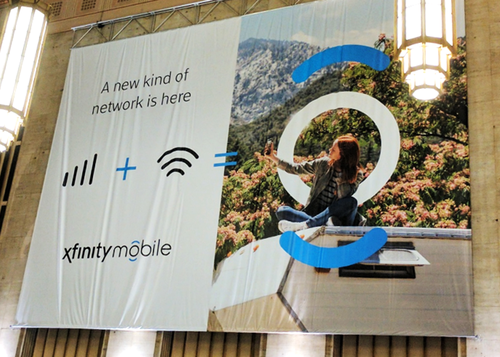 An Xfinity Mobile banner hangs in Philadelphia's 30th Street Station.