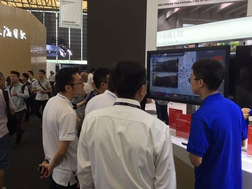 Qualcomm booth visitors observing our TDD Gigabit LTE network simulation.