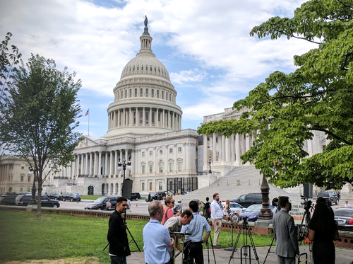 Net neutrality advocates prepare ahead of a press conference in the so-called 'Senate Swamp.'