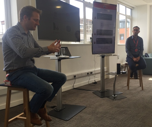 Neil Blagden (left), Vodafone UK's customer operations director, and Richard Clarke (right), its head of contact transformation, demonstrate a range of new digital technologies at the operator's offices in central London.