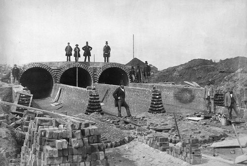 The London sewage system being built in 1860: The ones in top hats are the bosses.