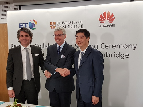 Awkward! From left to right: BT's Gavin Patterson, Cambridge University's Professor Stephen Toope and Huawei's Ken Hu feel the love at the launch of their joint research project.
