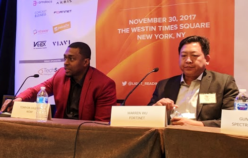 WOW's Torryon Coleman, left speaks next to Warren Wu of Fortinet at a Light Reading event.