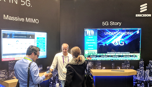 Ericsson staff show off the company's range of 5G technologies.