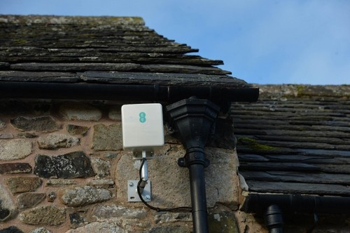 EE's 4G antenna is attached to the side of the home, satellite dish-style.
