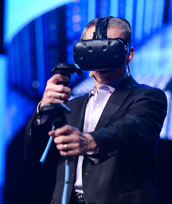 VMware CEO Pat Gelsinger makes a point and tries a virtual reality demo at his Dell Technologies World keynote Monday. Photos by VMware.
