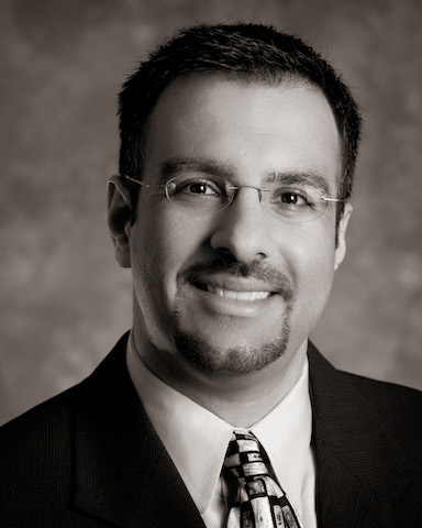Guavus CEO Faizel Lakhani, corporate headshot.