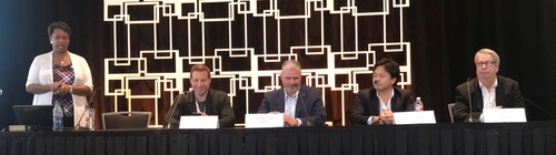 Heavy Reading's Roz Roseboro; Linux Foundation's Chris Aniszczyk. MetTel's Edward Fox III, NTT Innovation Institute's Icihiro Fukuda and SevOne's Steve Plotkin.