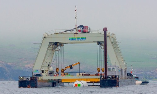 Project Natick's Northern Isles datacenter is partially submerged, held up by winches and cranes between the pontoons of an industrial catamaran-like gantry barge. Photo by Microsoft.