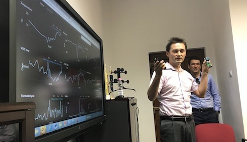 Radu Motisan, the founder of uRADMonitor, shows off his company's air-monitoring software in Alba Iulia.