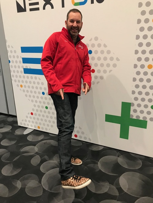 Google's Seligman, pointing proudly to his giraffe shoes. He says his daughter loves giraffes. (See Google Cloud Next in Photos, With Gorgeous Giraffe Footwear
