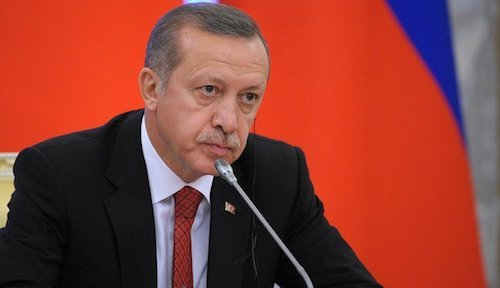 Telecom analyst and Turkish President Recep Tayyip Erdogan puts on his serious face.