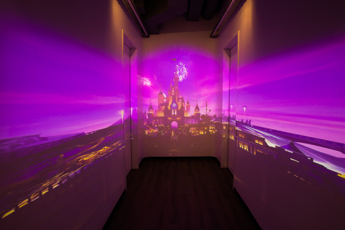 Take an ugly hallway and use projectors to wrap it in stunning imagery and add interactivity to produce something quite a bit different than the usual banner or movie poster. Photo courtesy of The Walt Disney Studios.