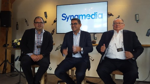 Dr. Abe Peled (right) is ready to tell the hacks at IBC what Synamedia is all about. He's joined by incoming CEO Yves Padrines (center) and Paul Dale (left) from Astro, a Cisco video/Synamedia customer based in Malaysia. Dale noted that he's glad to have a tech partner that deals with the hard platform-building work while he can get on with delivering the services.