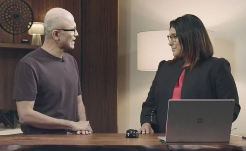 Navrina Singh, Microsoft principal product lead for AI (right), demonstrates Dynamics 365 AI for Customer Service for CEO Satya Nadella.