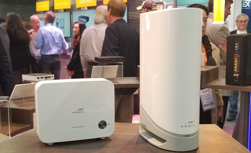 Arris said its new WiFi 6-capable DOCSIS 3.1 gateway (pictured at right) can work with 'EasyMesh'-certified WiFi extenders from Arris (pictured at left) or from third parties.