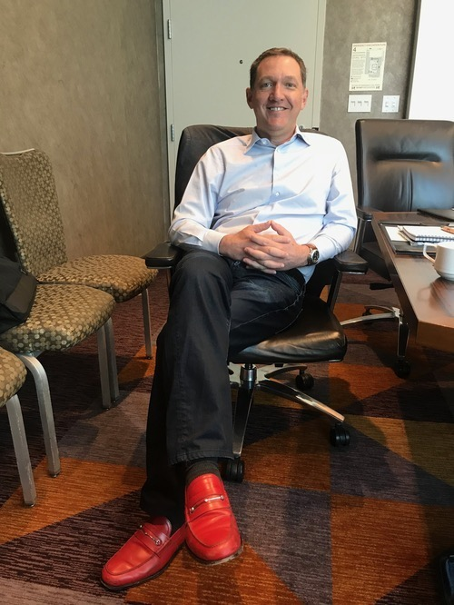 Why is Red Hat CEO Jim Whitehurst looking so happy? Oh right...