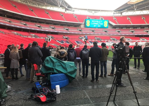 Reporters and analysts gather round for BT's 5G display (the white cylinder in the foreground is the Huawei device that provides connectivity to the stadium antenna).