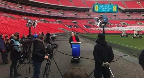 BT Sport Presenter Matt Smith participates in a demonstration of 5G technology at London's Wembley Stadium.