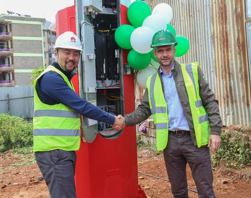 Huawei Kenya CEO Stone He (left) and Safaricom Chief Technology officer Thibaud Rerolle (right) cutting the ribbon during the launch of TubeStar basestation. The balloons cost extra.