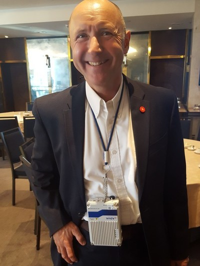 ADVA's Stephan Rettenberger sported the FSP 150-GO102Pro device as 'backhaul bling' at Light Reading's 2020 Vision Executive Summit in Lisbon (until it took a toll on his neck -- it's small but...)