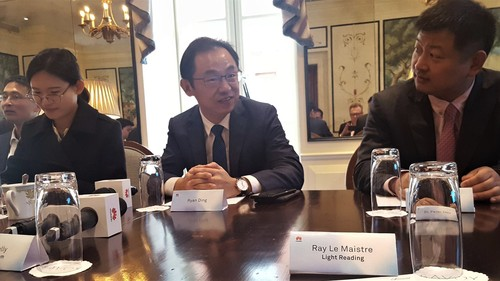Ryan Ding, head of Huawei's Carrier Business division, answers questions from the media in London.