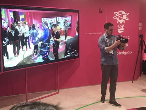 A cameraman films players of a new VR game developed by Deutsche Telekom, Niantic and Samsung.