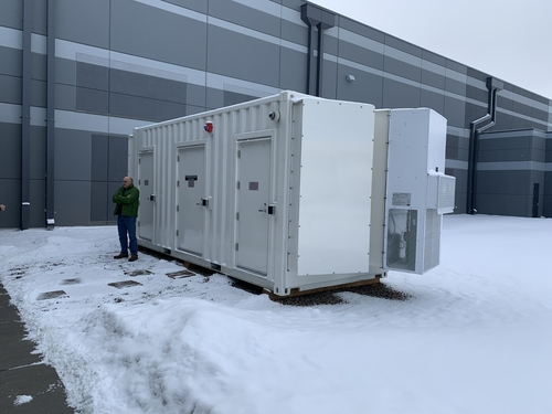 EdgeMicro's edge computing data center is essentially stored inside a big steel shipping container, like the kind of shipping containers that can be placed on cargo ships, railroad cars or 18-wheelers. It's located immediately outside of Flexential's massive data center in Englewood, Colo. (meaning, it's literally about five feet away from one of the side exits to Flexential's data center). 