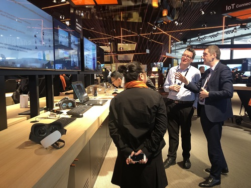 Orange's Arnaud Vamparys (at right of picture) talks to Light Reading at the French operator's MWC stand.