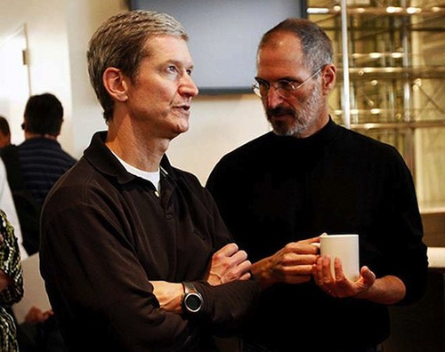 Tim Cook, Apple's current CEO (left), stands alongside founder and former CEO Steve Jobs.