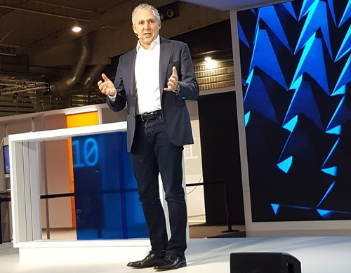 Telstra's Andrew Penn addresses attendees at Mobile World Congress in Barcelona.