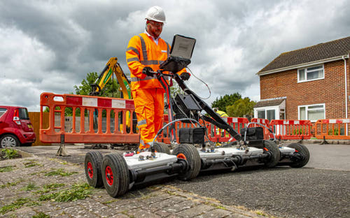 An Openreach engineer uses GPR technology to detect hidden obstacles before digging in fiber cables, in Salisbury.