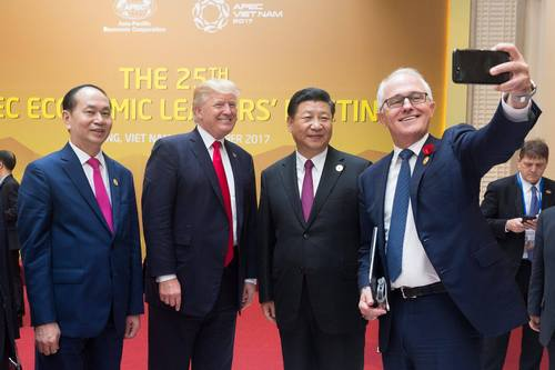 Donald Trump and Xi Jinping are 'selfied' by former Australian Prime Minister Malcolm Turnbull.