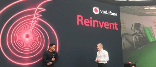 South African rugby star Juan de Jongh (left) feels the impact of a tackle on a training bag 100 miles away, while Scott Petty, Vodafone UK's chief technology officer, looks on.