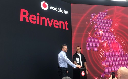 Vodafone CEO Nick Jeffery (left) and Formula 1 race car driver Lewis Hamilton hit the button.