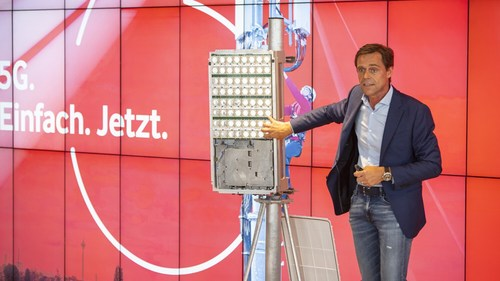 Gerhard Mack, Vodafone Germany's chief technology officer, shows off his new Ericsson gear in Dusseldorf.