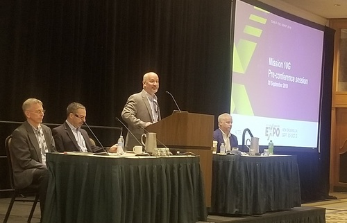 SCTE's Chris Bastian (at the lectern) welcomes the crowd to a pre-conference session on 10G. Joining him (left to right) are Tom Cloonan, CommScope; Bob Ferriera, Intel; and Brian Scriber, CableLabs.