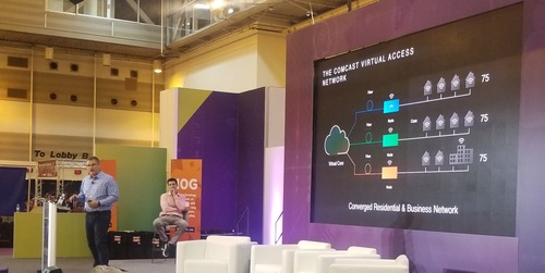 Comcast's Elad Nafshi (front of stage) and Jan Hofmeyr provided an update on the operator's access network virtualization efforts.